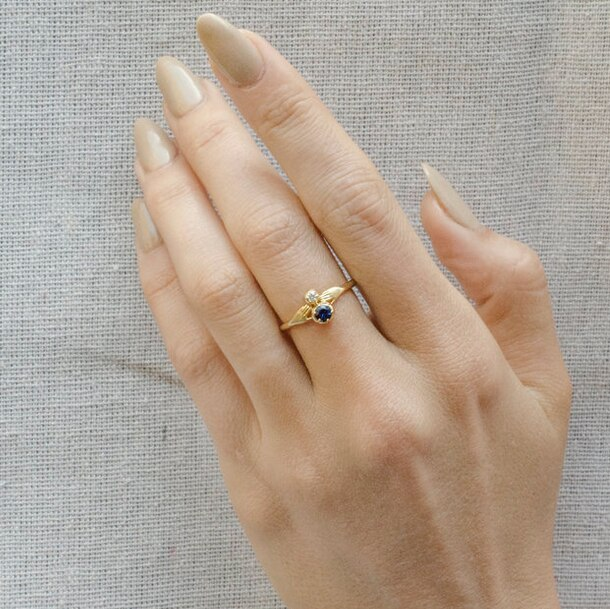 Sapphire and Diamond tiny hands ring by Anthony Lent, shop online at tomfoolery London | www.tomfoolerylondon.co.uk
