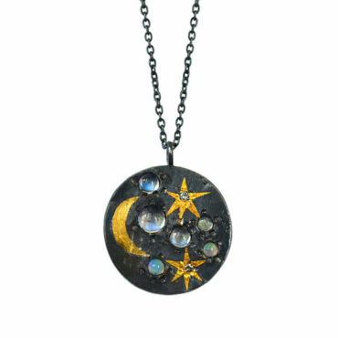 Large space scape coin pendant by Acanthus available to shop online at tomfoolery London   www.tomfoolerylondon.co.uk