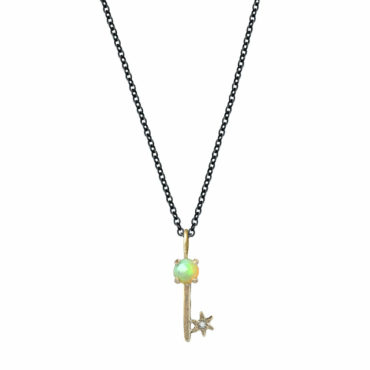 Opal Key Amulet Charm Necklace by Acanthus available to shop online at tomfoolery London | www.tomfoolerylondon.co.uk